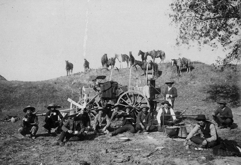 Cowboys Eating Dinner On The Range