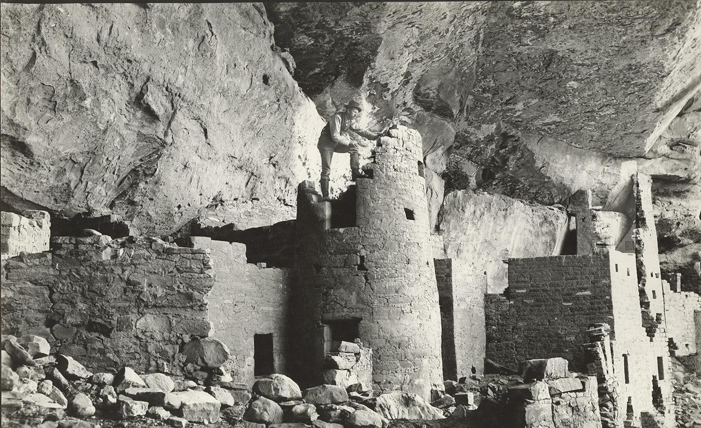 National-Parks_Examining-the-ruins-at-the-Cliff-Palace-Mesa-Verde-National-Park-circa-1900