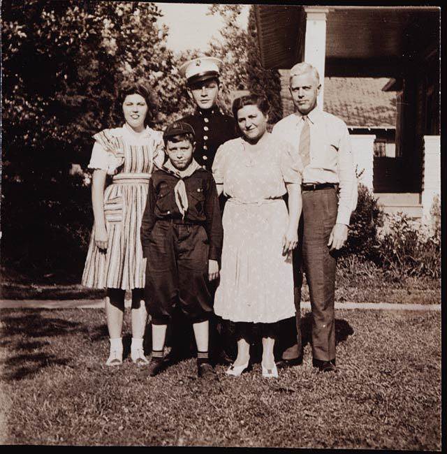 Phillips family photo at Monterey Place, May 1942. Sid poses in Marine blues next to Katharine.