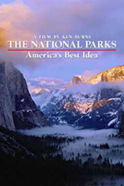 """A color poster for the film """"The National Parks: America's Best Idea."""" It depicts a sweeping vista between enormous, fog-draped mountain ranges, ringed in purple and gold colors."""
