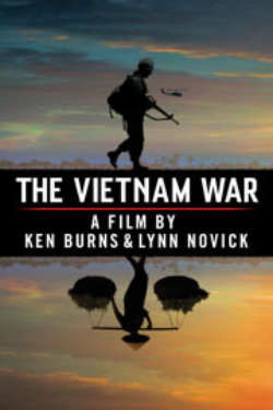 The poster for 'The Vietnam War: A Film By Ken Burns & Lynn Novick.' It shows a silhouetted American soldier standing above the film's title, with his reflection being that of a Vietnamese farmer carrying bales of rice on his shoulders. There is a silhouetted helicopter in the sky, which has a dramatic orange and blue sunset.