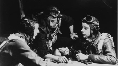 Luverne's Quentin Aanenson, left, prepares for the next mission. August 3, 1944. | Luverne, Minnesota