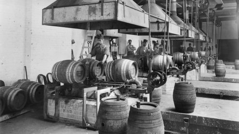 Interior view of Pawling & Harnischfeger showing kegs on assembly line, Milwaukee, Wisconsin. | Unintended Consequences