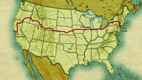 A photo depicting a map of the United States of America, with a red line plotting Horatio Nelson Jackson's route.   The Map